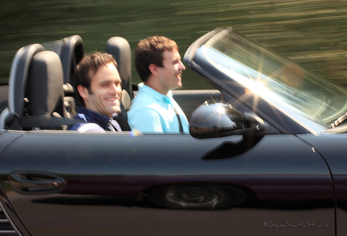 young men enjoy brisk ride in PORSCHE Boxter convertible