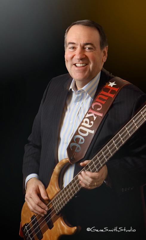 Governor Huckabee photographed with his electric bass instrument in his office across from the Radio City Hall building in the Fox News Center in Manhattan, NY, New York.