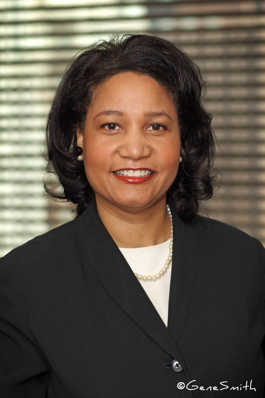 Attractive female executive posed for headshot portrait in conference room Philadelphia, PA.