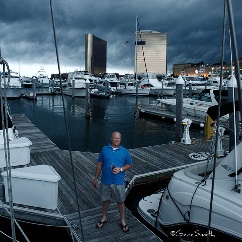 boater stands on marina dock as storm front arrives