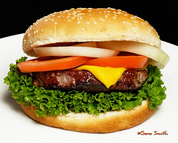 big cheeseburger with lettuce, onion and tomatoe
