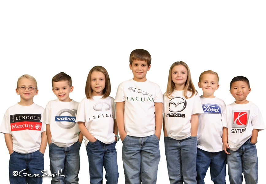Group of kids with automotive logos pictured for billboard