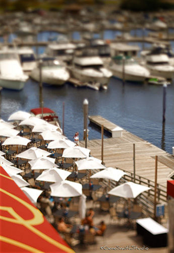 Waterfront bar and restaurant photographed with tiny-town photographic effect