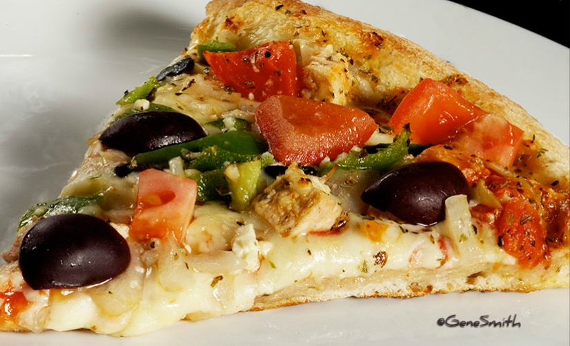 Pizza Slice wth vegetable toppings