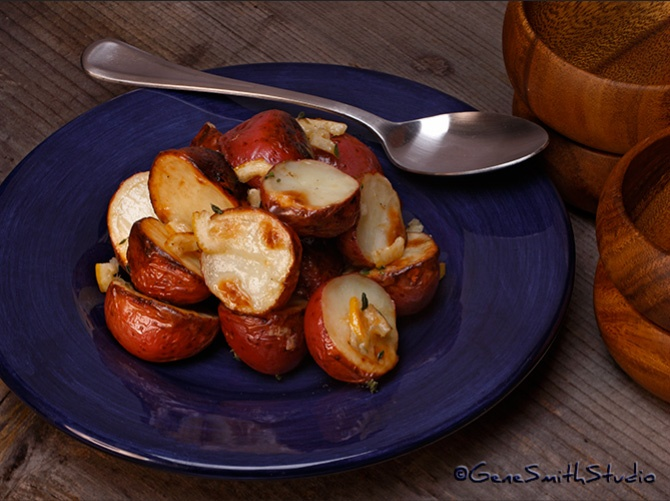 Roasted Potatoes on dark blue serving plate