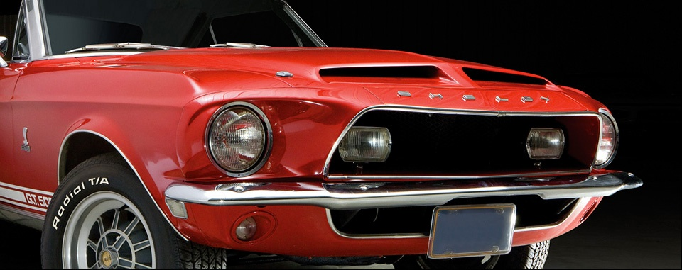 Red Shelby GT 500 photographed in a front 3/4 view by Gene Smith Studio for Condon & Skelly Classic Car Insurance.