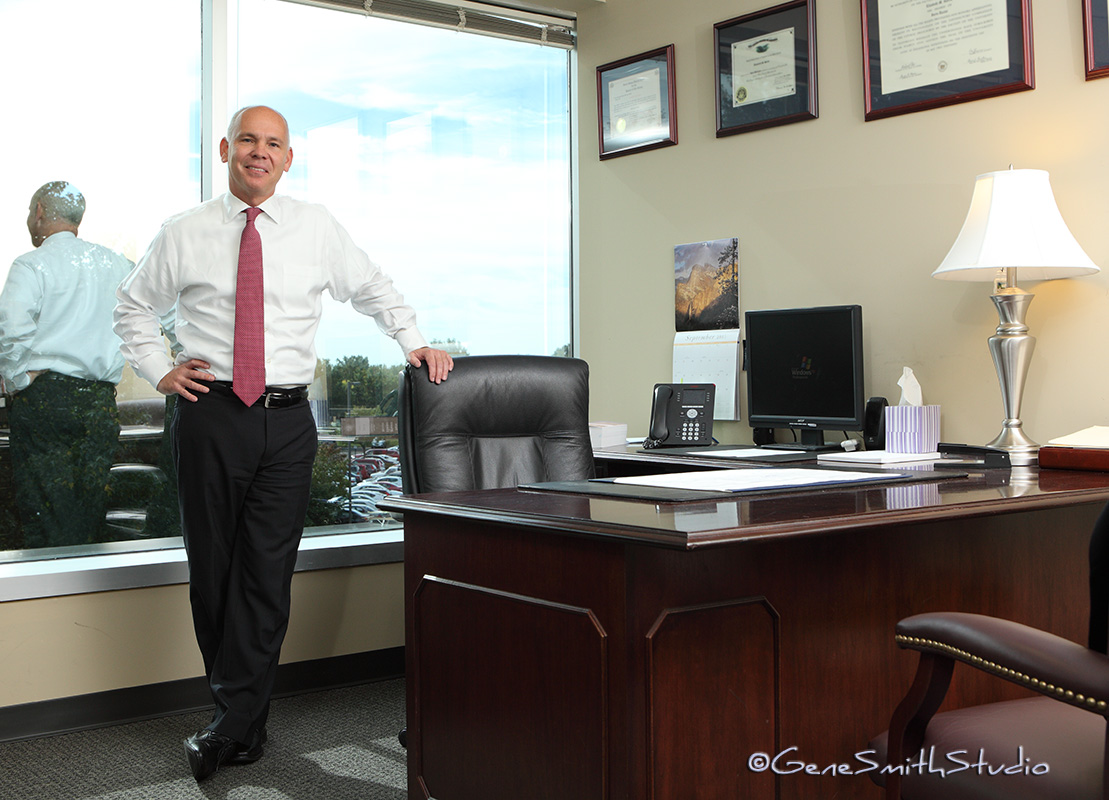 executive photographed standing in his office