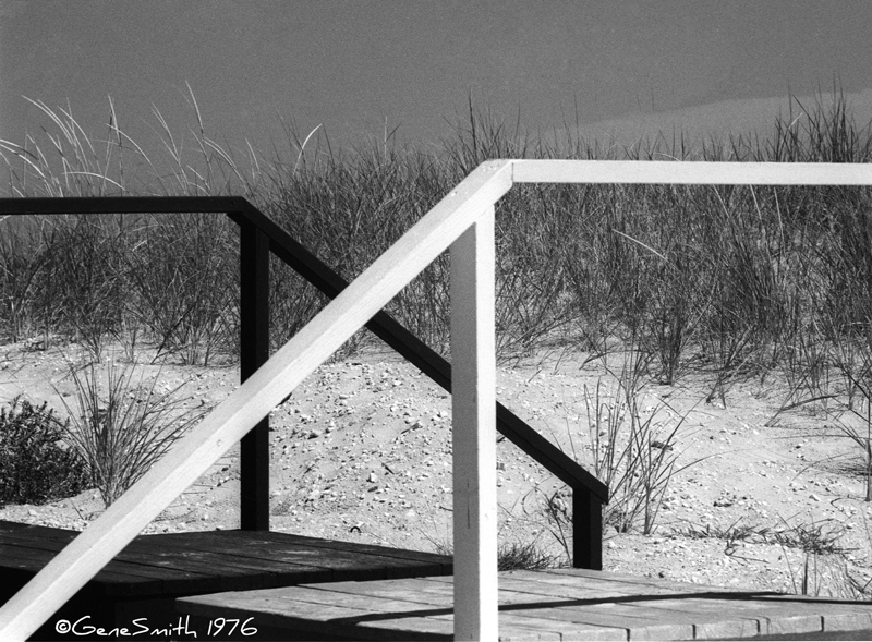 beachside boardwalk with railings one painted white one painted black