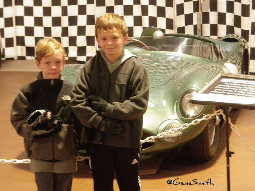 young boys pose in front of Aston Marten DB3 at Simone Museum