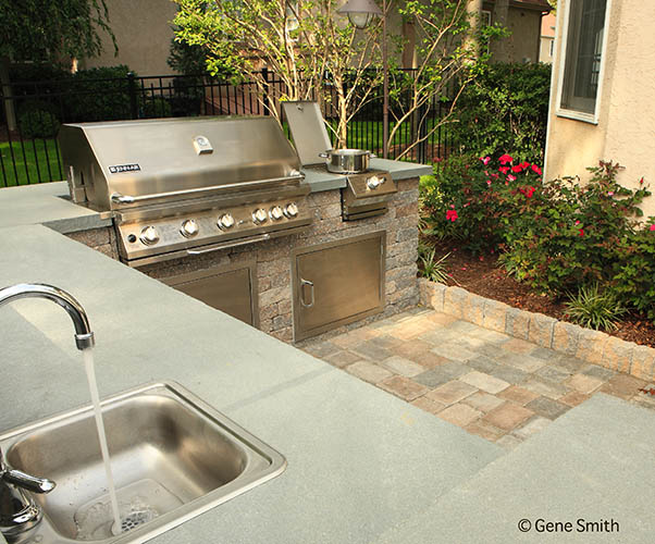 Outdoor patio with kitchen and grill