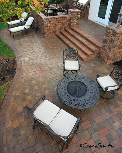 home patio with fire pit and lounges