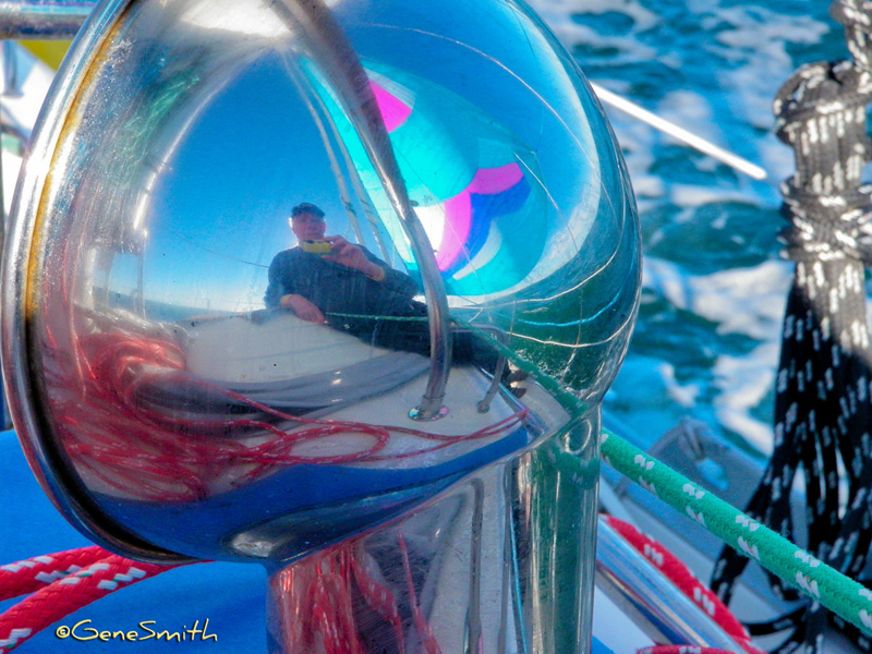 sailor photographs reflection in chrome Dorade ventilator