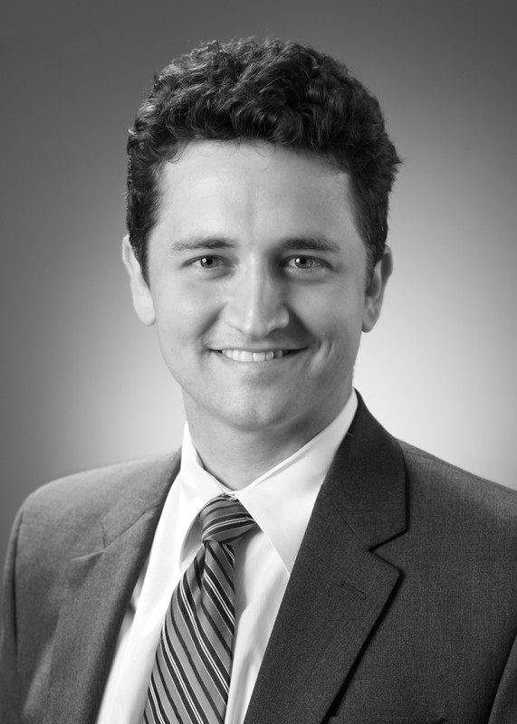 B&W portrait headshot of young male attorney