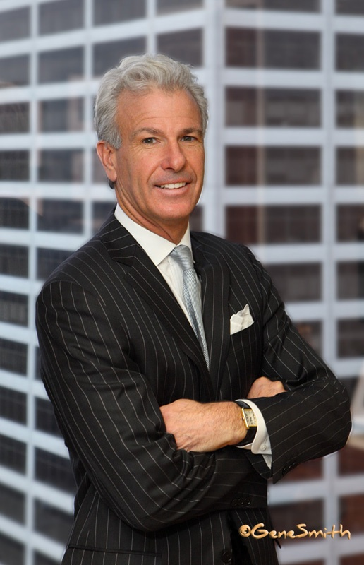 Sam Pond posed for Attorney at Law MAgazine cover photo by Gene Smith Studio. In background is Center City offices.