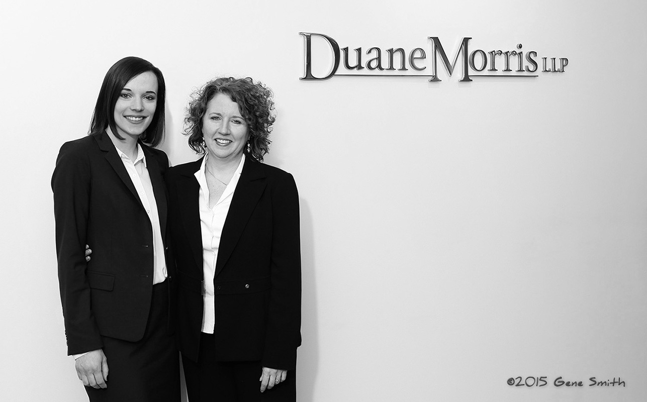 two women attorneys photographed in front of Duane Morris sign