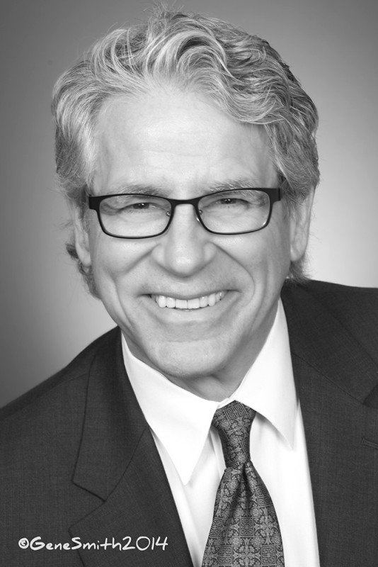 B&W photo headshot of attorney on plain grey background.