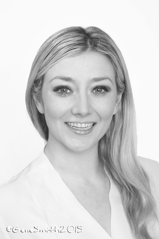 B&W headshot portrait of young woman for marketing company