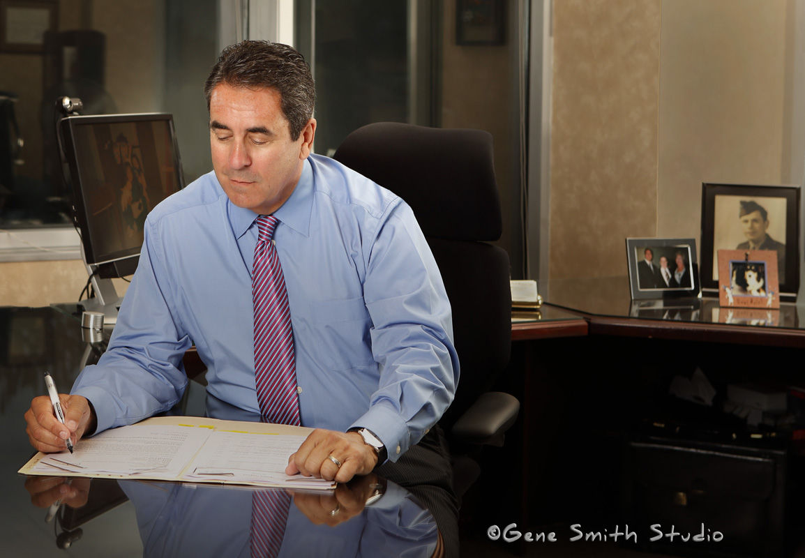 Attorney in shirtsleeves working in the evening at his desk in Voorhees, NJ photographed by Gene Smith for attorney's professional website. More than just a headshot this environmental portrait tells a story about the subject and what he does.