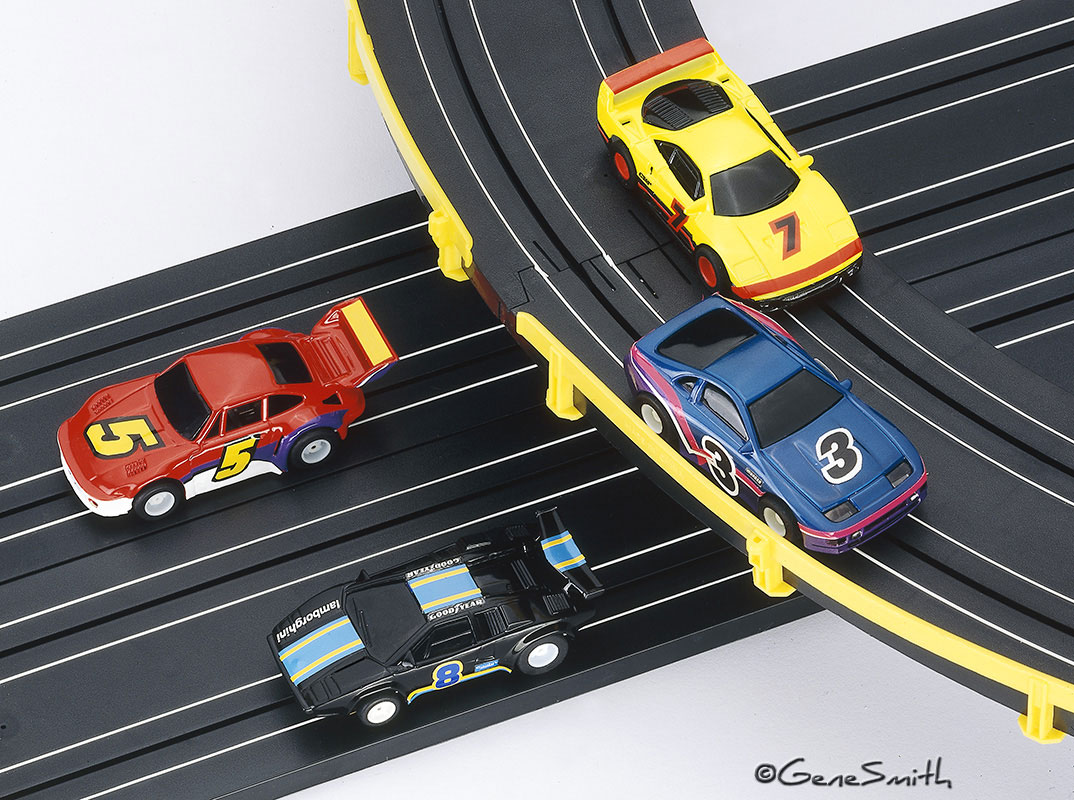 Toy electric slot car racing cars and track