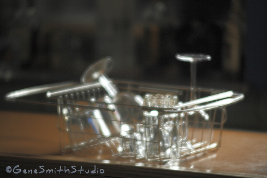 Dish rack with cocktail glasses on bar made with soft focus lens