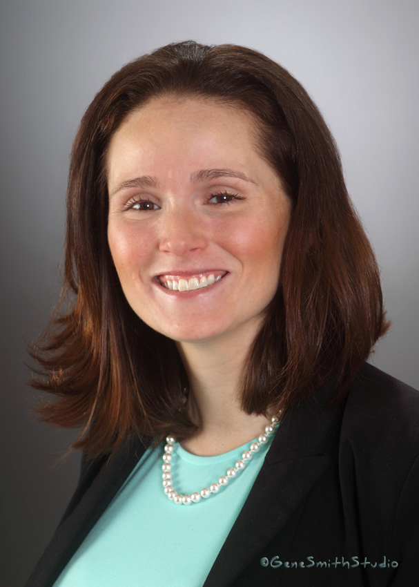 Young attractive woman's corporate headshot portrait