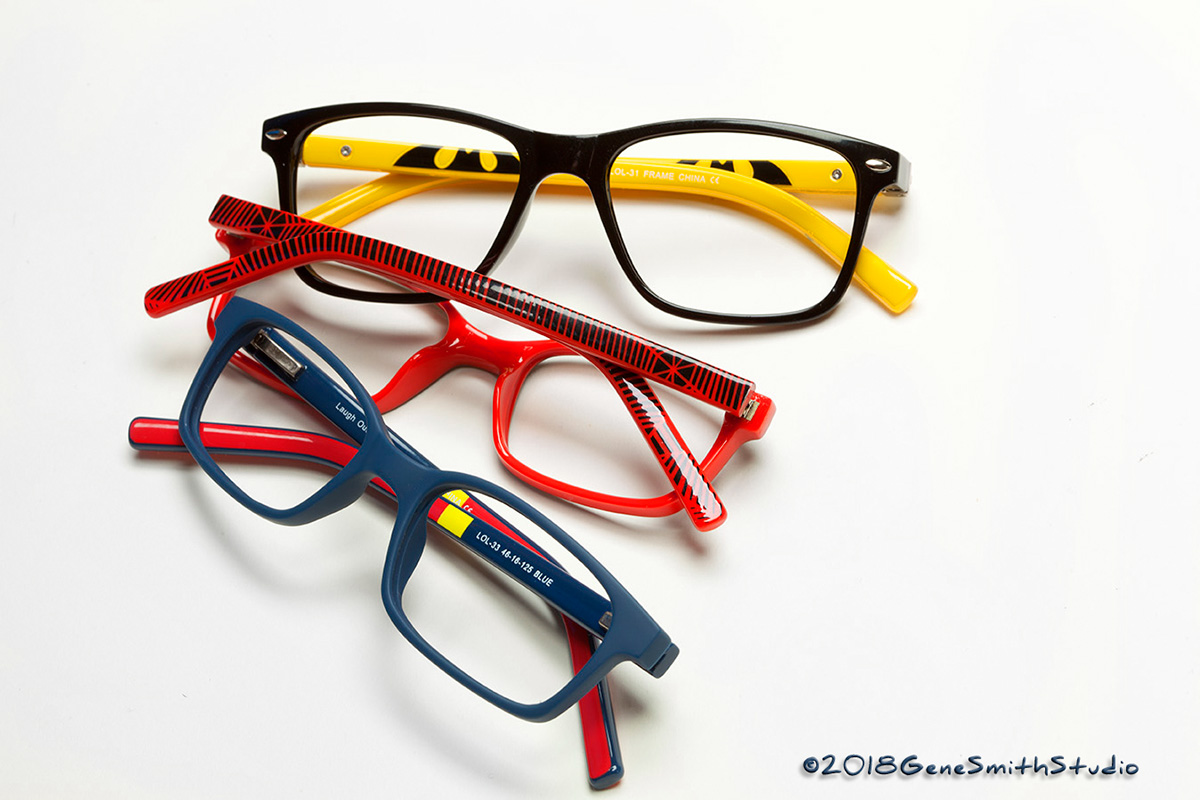 Brightly colored eyeglass frames feature graphics from comic book superheroes.