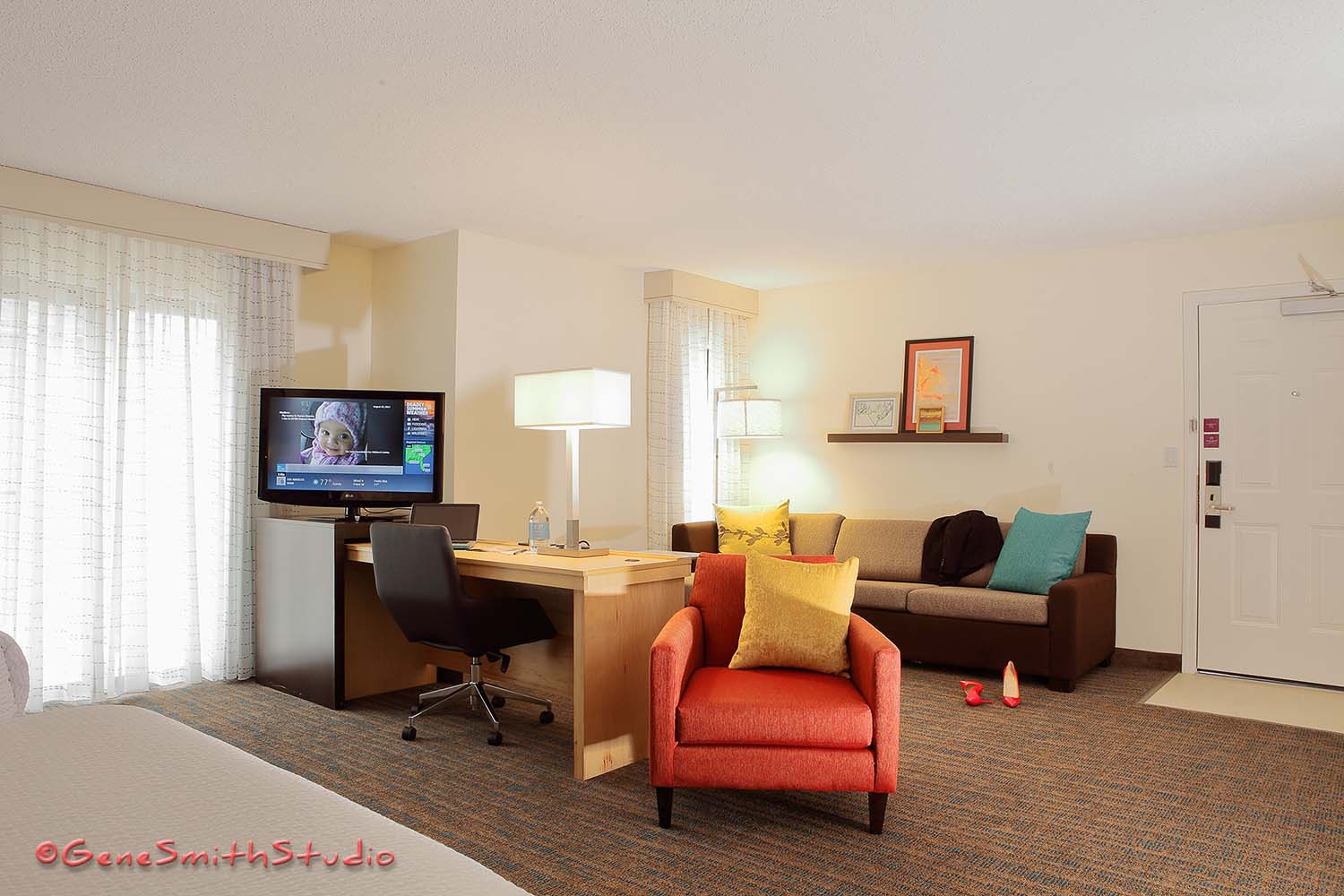 Bright airy photo of newly renovated Marriott Residence Inn hotel room.