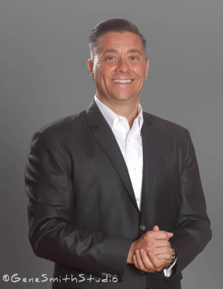 Executive in suit photographed on gray background for Xerox corporate websites.