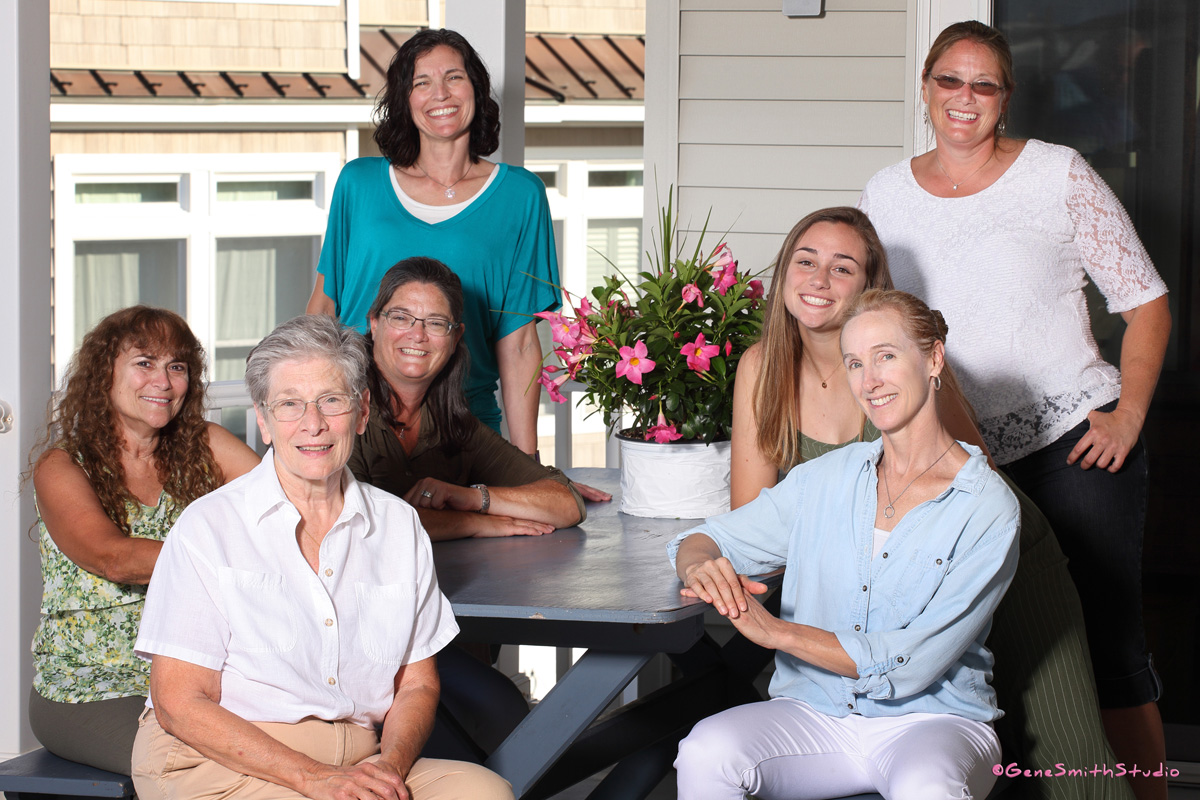 Outdoor family portrait at vacation home at seashore