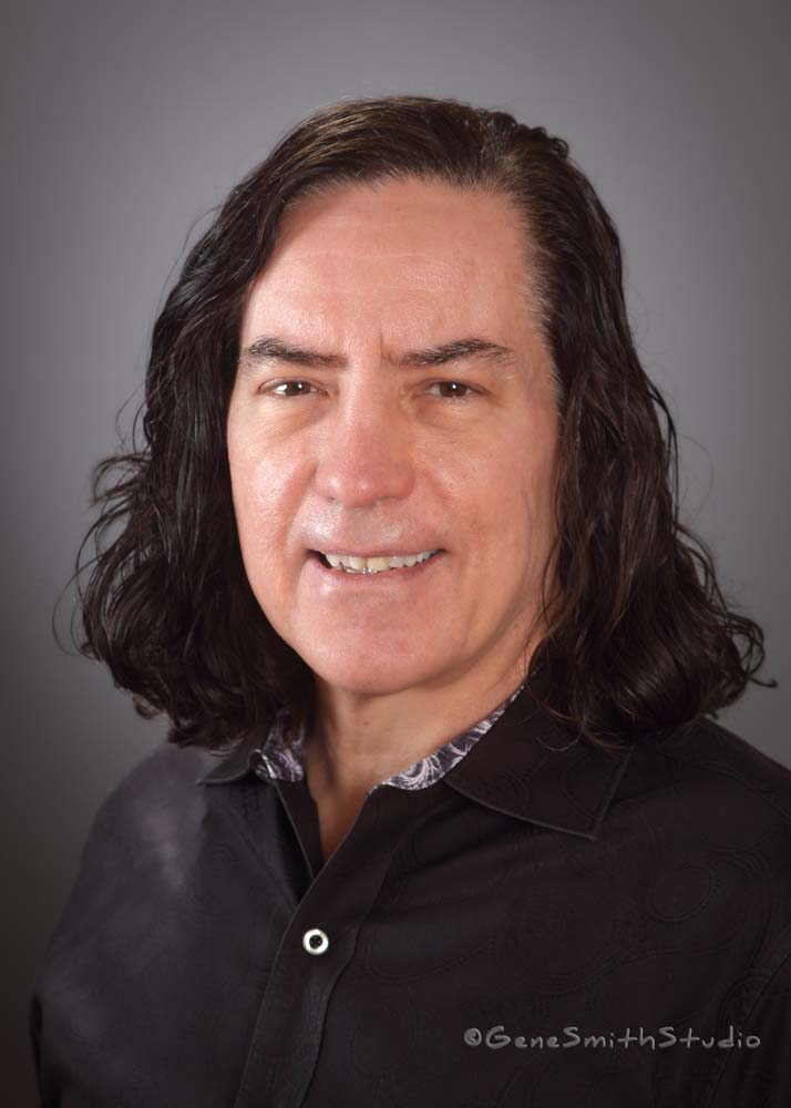 Executive with long black hair headshot